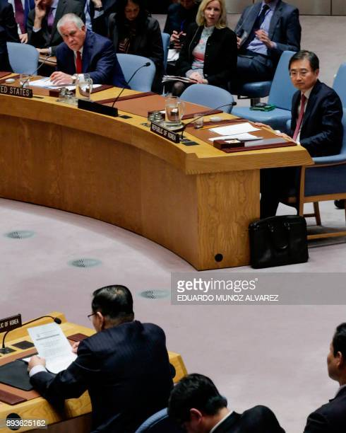 South Korea's Vice Foreign Minister Cho Hyun and US Secretary of State Rex Tillerson listen to North Korea's ambassador to the UN Ja Songnam speak...