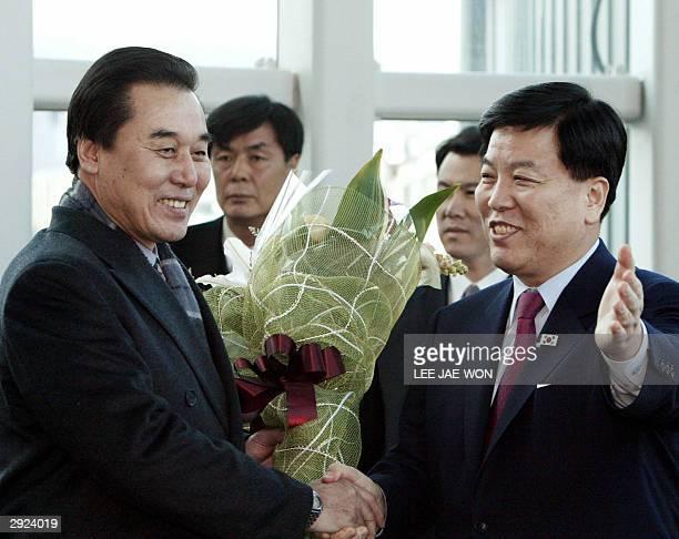 South Korea's vicefinance minister Kim Gwangrim greets North Korean delegation leader Kim Ryungsung upon the latter's arrival at Inchon airport west...