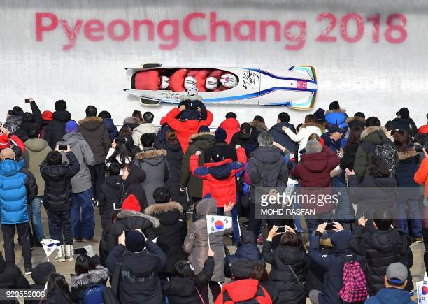 TOPSHOT South Korea's Won Yunjong leads his team in the 4man bobsleigh heat 1 run during the Pyeongchang 2018 Winter Olympic Games at the Olympic...