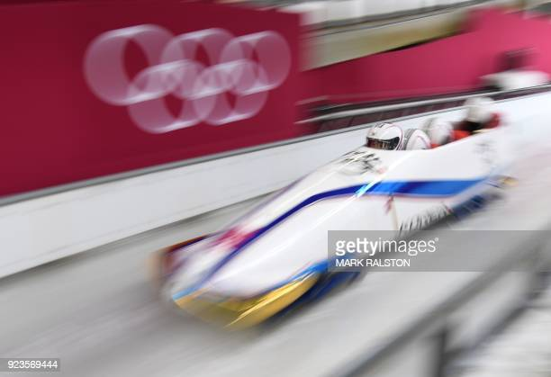 TOPSHOT South Korea's Won Yunjong leads his team in the 4man bobsleigh heat 2 run during the Pyeongchang 2018 Winter Olympic Games at the Olympic...