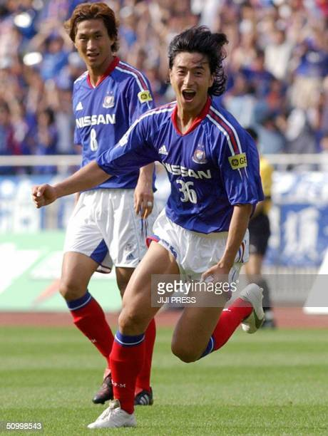 South Korea's World Cup hero Ahn JungHwan of Yokohama F Marinos celebrates his winning goal during a JLeague football match against Kashima Antlers...