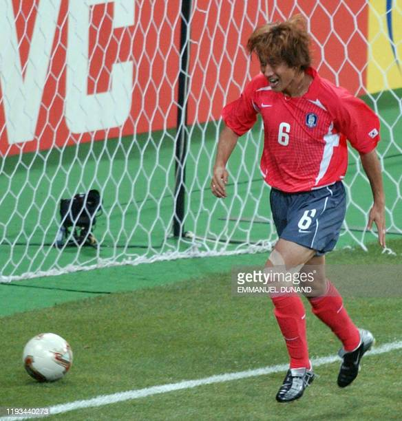 South Korea's Yoo Sang Chul runs past the ball he put in the back of the net after scoring against Poland in the 53rd minute, 04 June 2002 at the...