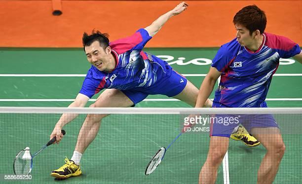 South Korea's Yoo Yeon Seong and South Korea's Lee Yong Dae return to Taiwan's Sheng Mu Lee and Taiwan's Chia Hsin Tsai during their men's doubles...