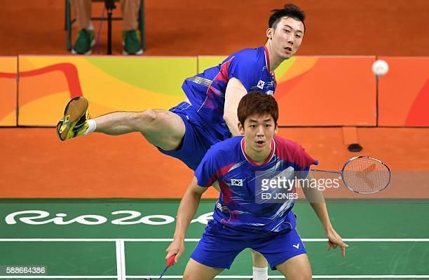 South Korea's Yoo Yeon Seong and South Korea's Lee Yong Dae serve to Taiwan's Sheng Mu Lee and Taiwan's Chia Hsin Tsai during their men's doubles...
