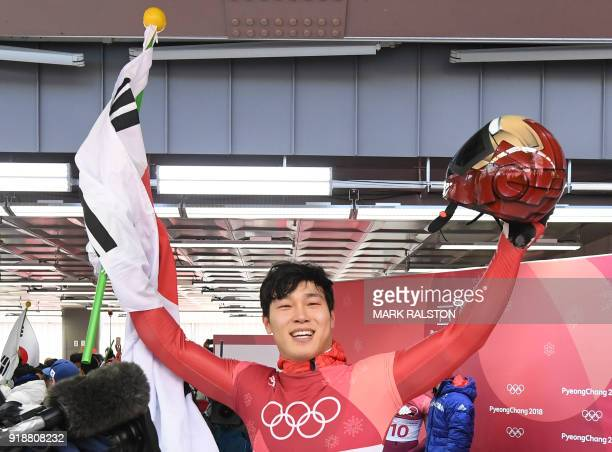 TOPSHOT South Korea's Yun Sungbin celebrates getting the gold in the mens's skeleton heat 4 final run during the Pyeongchang 2018 Winter Olympic...