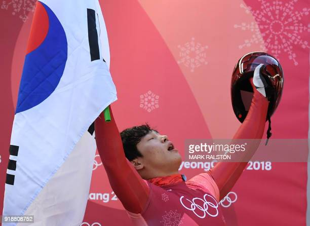 South Korea's Yun Sungbin celebrates getting the gold in the mens's skeleton heat 4 final run during the Pyeongchang 2018 Winter Olympic Games at the...