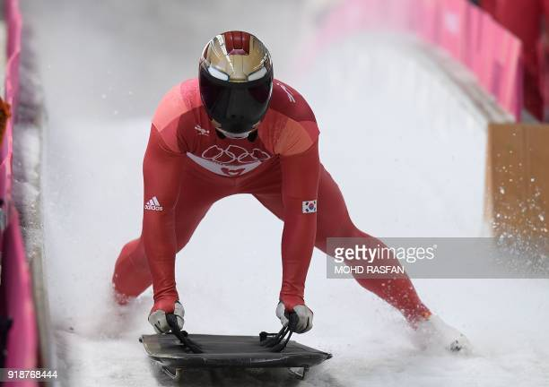 South Korea's Yun Sungbin slows down at the end of the mens's skeleton heat 3 run during the Pyeongchang 2018 Winter Olympic Games, at the Olympic...