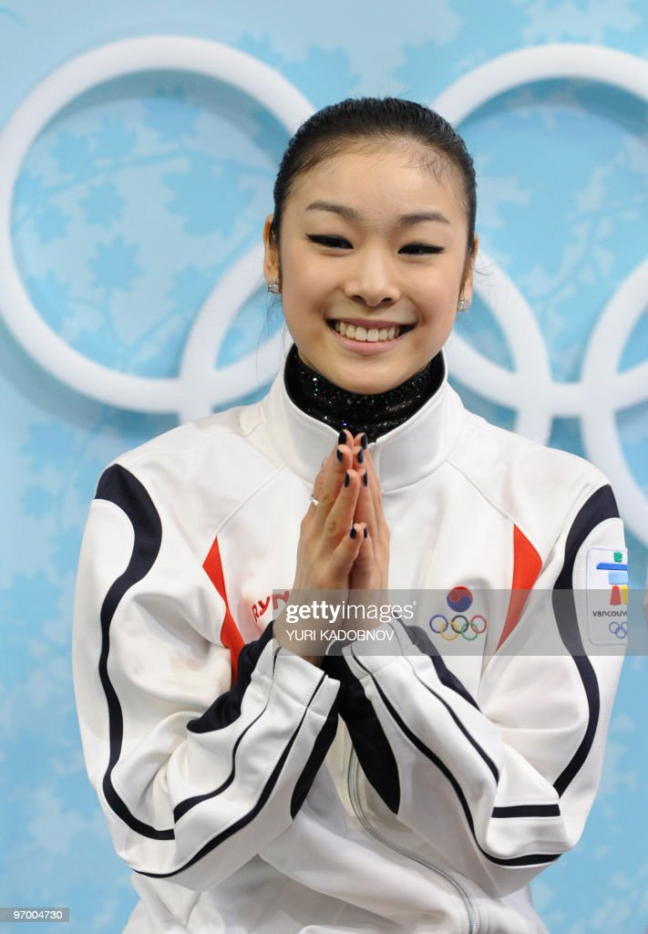 South Korea's Yu-Na Kim reacts in the kiss-and-cry area after performing in the Ladies' Figure Skating Short Program in Vancouver, during the 2010 Winter Olympics on February 23, 2010.
