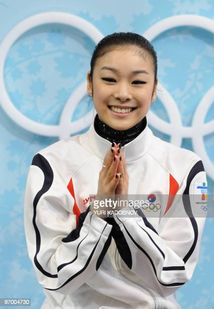 South Korea's YuNa Kim reacts in the kissandcry area after performing in the Ladies' Figure Skating Short Program in Vancouver during the 2010 Winter...