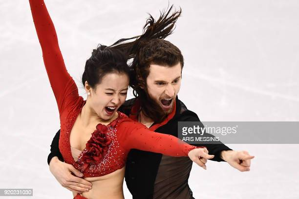 South Korea's Yura Min and South Korea's Alexander Gamelin compete in the ice dance short dance of the figure skating event during the Pyeongchang...