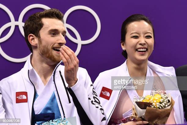 South Korea's Yura Min and South Korea's Alexander Gamelin react after competing in the ice dance free dance of the figure skating event during the...