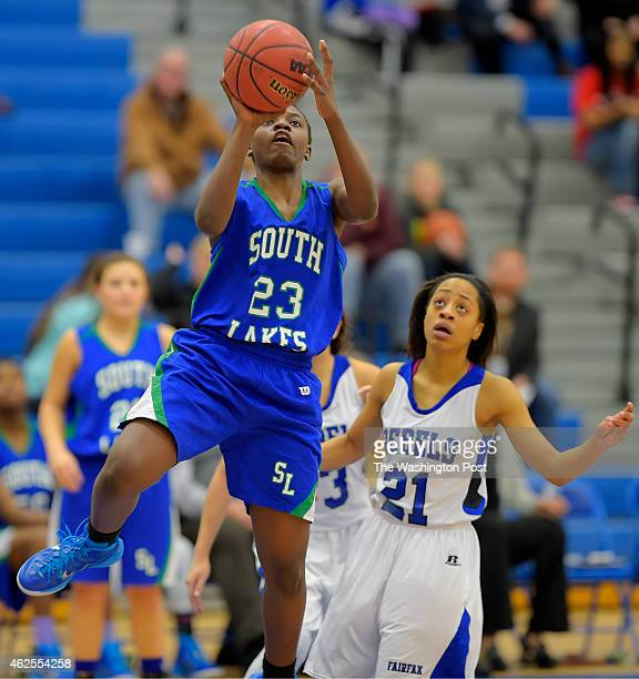 South Lakes' Brenda Kamga left drives for a 4th quarter basket during South Lakes' defeat of Fairfax 51 49 in girls basketball at Fairfax High School...
