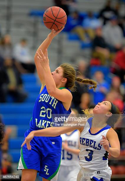 South Lakes' Maddie Young left flies past Fairfax's Alex Wendling for a 4th quarter score during South Lakes' defeat of Fairfax 51 49 in girls...