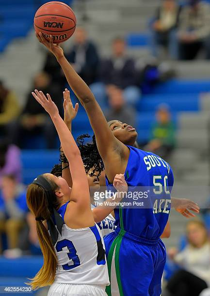 South Lakes' Princess Aghayere right grabs a rebound over Fairfax's Alex Wendling during South Lakes' defeat of Fairfax 51 49 in girls basketball at...