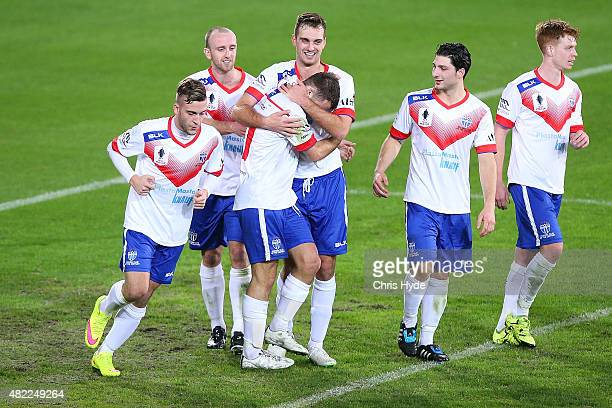 South Melbourne celebrate a goal by Bradley Norton during the FFA Cup match between Palm Beach and South Melbourne at Cbus Super Stadium on July 29...