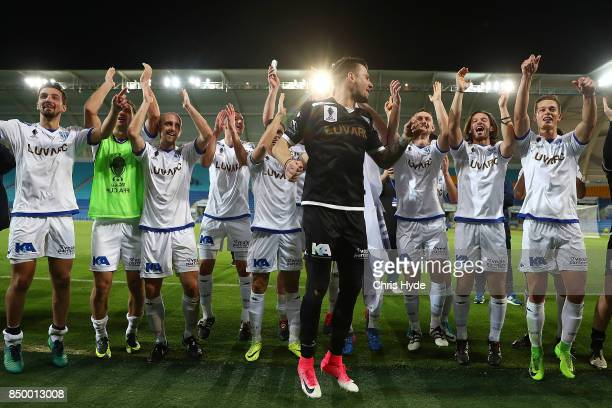 South Melbourne celebrate winning the FFA Cup Quarter Final match between Gold Coast City FC and South Melbourne at Cbus Super Stadium on September...
