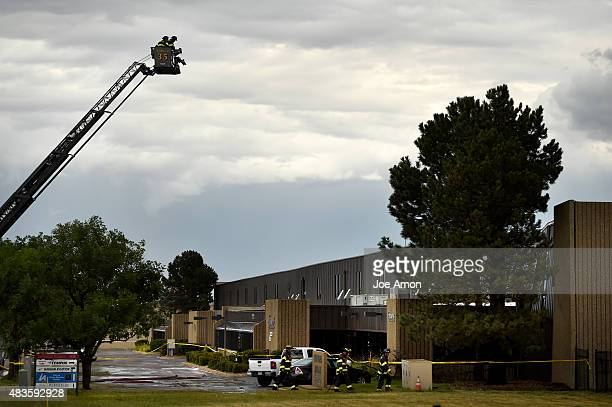 South Metro firefighters and a building inspector get a better view of the partially collapsed roof before entering the Tempus Aircraft section of a...