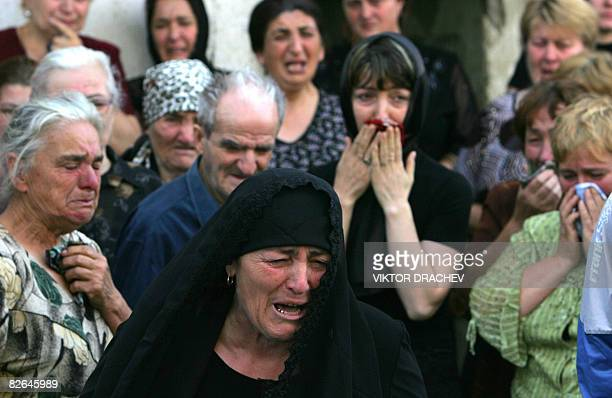 South Ossetians cry during a funeral of South Ossetian peacekeeper Akhsar Kiliksayev who died after being wounded in the recent armed conflict...