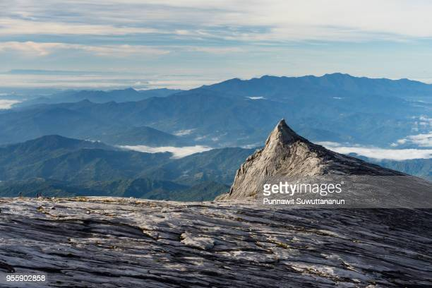 south peak, iconic peak of kinabalu mountain massif in boneo island, sabah, malaysia - cliff stock pictures, royalty-free photos & images