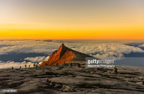 south peak ,mount kinabalu at sunrise viewed from the summit plateau - kota kinabalu stock pictures, royalty-free photos & images