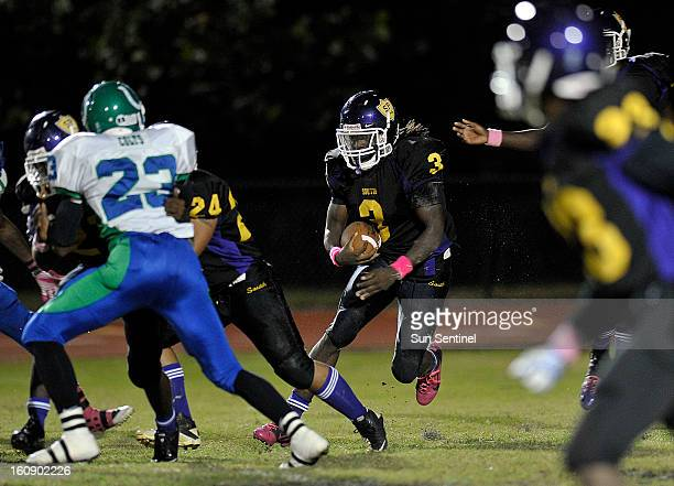 South Plantation running back Alex Collins looks for a hole in the Coral Springs defense in this October 21 file photo. Collins' birth father,...