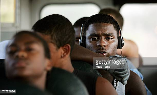South Plaquemines High School football players ride a bus on their way to their inaugural football game against Belle Chase High School September 1...