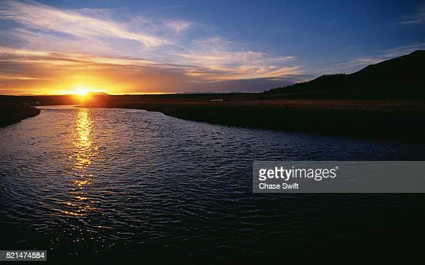 south platte river at sunset - swift river stock photos and pictures