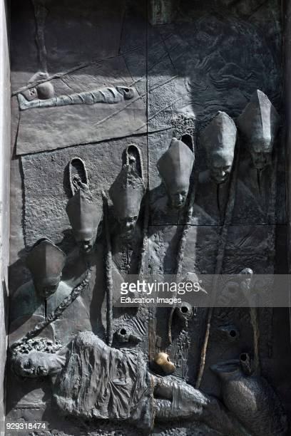 South side bronze sculptured door of St. Nicholas Catholic church Ljubljana Cathedral local bishops looking at dead shrouded Christ Ljubljana...