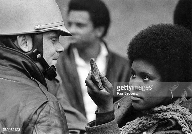 A South Side resident housing activist confronts a police officer during an eviction resulting from racist real estate policies that kept the Black...