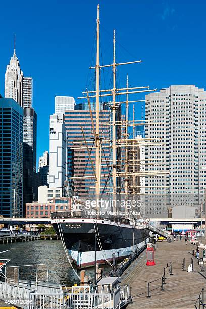 South Street Seaport: Peking, the four masted barque docked at Manhattan harbor, New York City. The Manhattan cityscape in the background. The Peking...