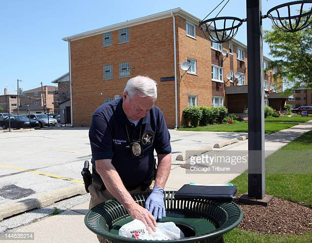 South Suburban Major Crimes Task Force investigators survey the area including looking into trashcans around the apartment building where Estrella...