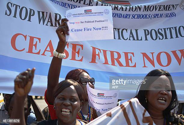 South Sudan Civil Society Alliance workers march on parliament during peaceful demonstrations on January 8 2014 denouncing the ongoing fighting and...