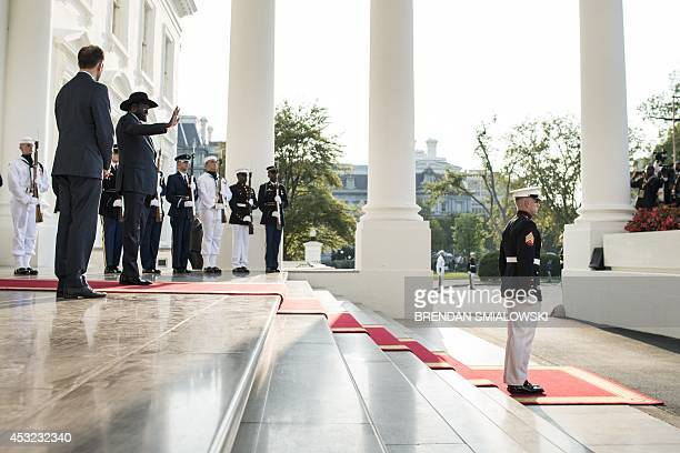 South Sudan President Salva Kiir Mayardit arrives at the White House for a group dinner during the US Africa Leaders Summit August 5 2014 in...