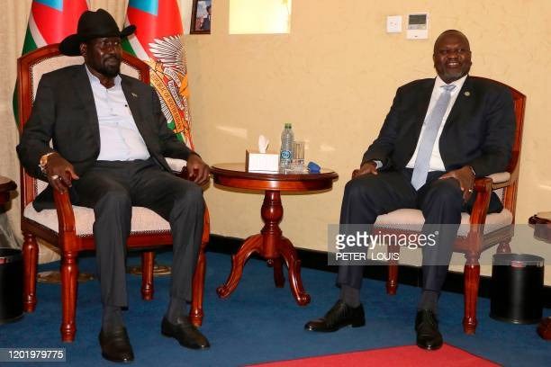 South Sudan President Salva Kiir Mayardit sits with his former vicepresident and political rival Riek Machar as they meet at the State House in Juba...
