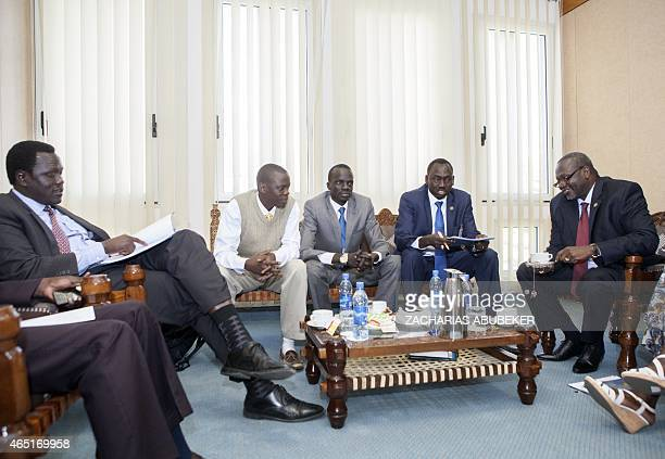 South Sudan rebel chief and former vice-president Riek Machar speaks with his delegation prior to a meeting on March 3, 2015 in Addis Ababa, as part...