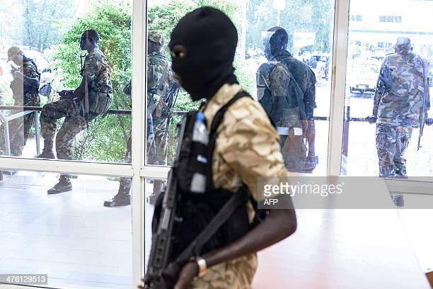A South Sudanese army soldier stands guard in a corridor during a visit of South Sudan's Petrolium Minister to the town of Paloch on March 2 2014...