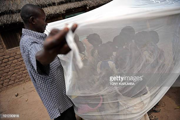 South Sudanese children are educated on the use of a longlasting insecticidetreated net in Wau about 520 km northeast of Juba on April 2 where the...