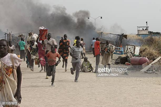TOPSHOT South Sudanese civilians flee fighting in an United Nations base in the northeastern town of Malakal on February 18 where gunmen opened fire...