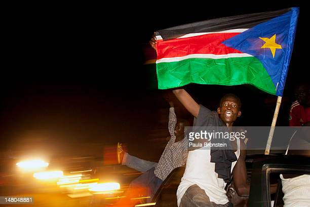 South Sudanese drive around waving the national flag celebrating into the night South Sudan's first anniversary of it's Independence day July 9, 2012...