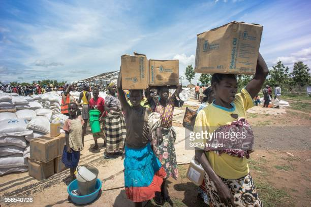 South Sudanese female refugees seen carrying palm oil on top of their heads as they were given these food supply by the world food program The Bidi...