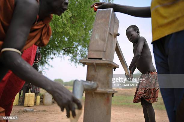 A south Sudanese girl pumps water from a borehole on April 2 in Terekeka 82 km north of Juba an area where the population is exposed to malaria a...