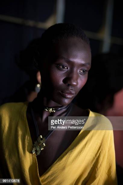 South Sudanese model Anyon Asola waits backstage before a show on August 17 2017 in Mall of Africa north of Johannesburg South Africa African...