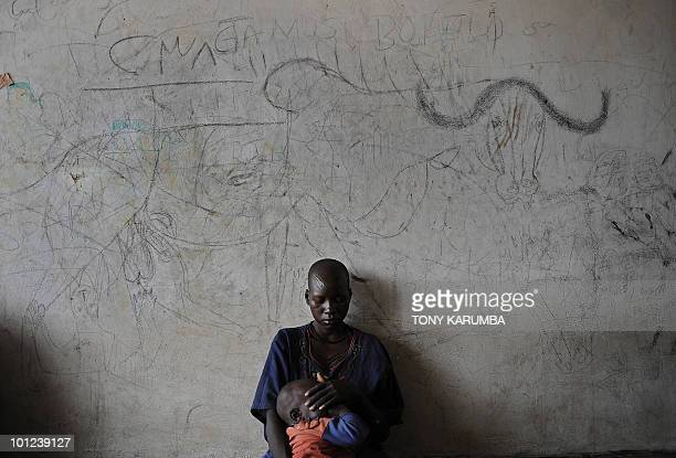South Sudanese mother and her child wait on April 2 to be attended to, at a health clinic in Terekeka, 51 miles north of Juba where the population is...