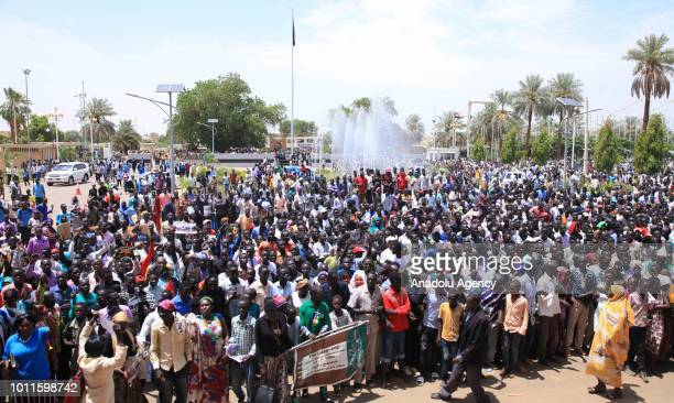 South Sudanese people stage a demonstration in support of the agreement between South Sudanese government and armed oppositions on sharing power and...