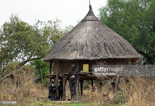 A south Sudanese pregnant mother with her children waits at their homestead on April 2 at Terekeka 82 km north of Juba an area where the population...