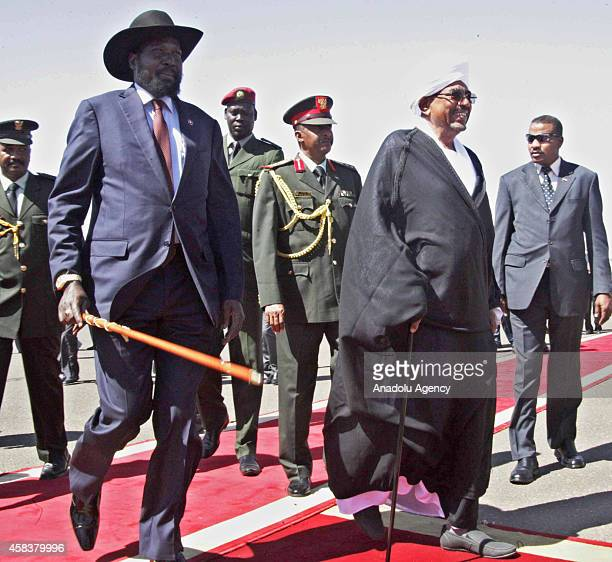 South Sudanese President Salva Kiir and his Sudanese counterpart Omar alBashir walk during a welcoming ceremony at the Khartoum International Airport...