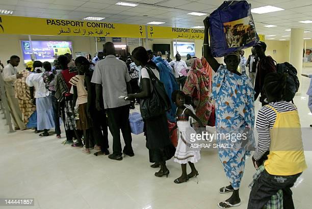 South Sudanese queue at passport control at the airport in Khartoum