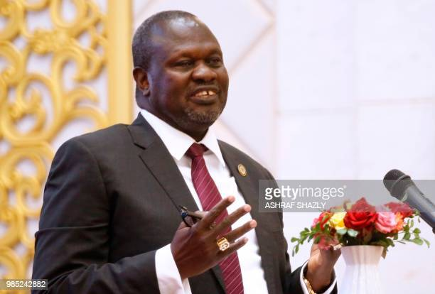 South Sudanese rebel leader Riek Machar speaks during the ceremony after the two South Sudanese archfoes agreed in Khartoum on June 27 to a permanent...