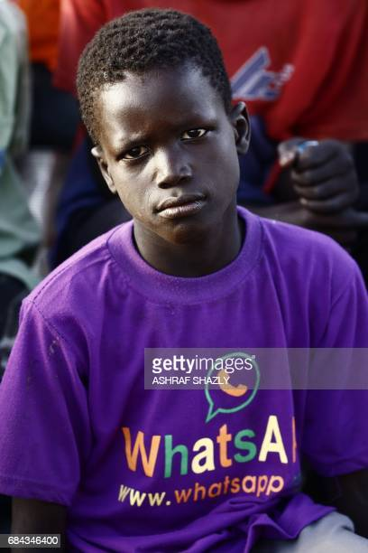 A South Sudanese refugee boy sits at the UNHCR camp of alAlgaya in Sudan's White Nile state south of Khartoum on May 17 2017 More than 95000 South...