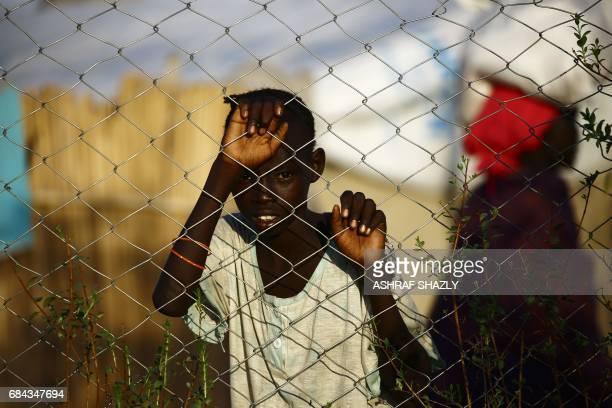 South Sudanese refugee child stands at the UNHCR camp of alAlgaya in Sudan's White Nile state south of Khartoum on May 17 2017 More than 95000 South...